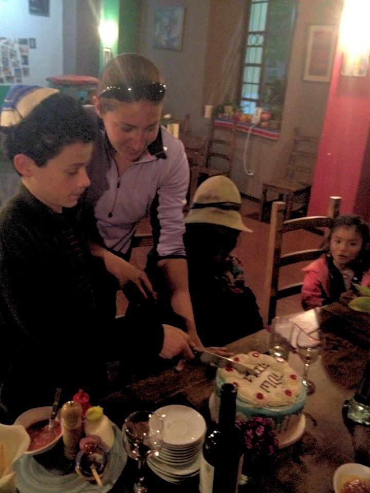 Rosh ha-shanah 2013 3 (maya helping jack cut the cake)