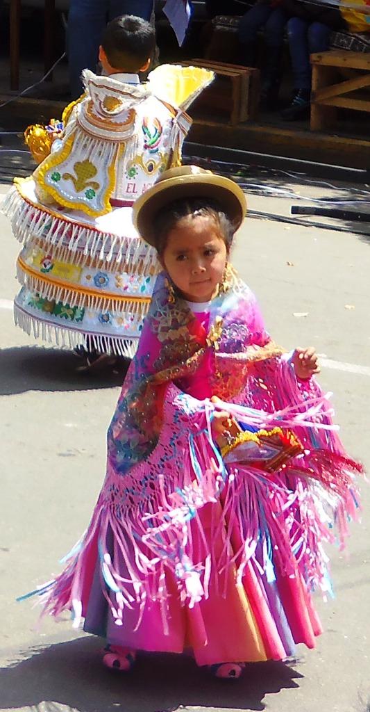 Two children of a morenada troupe compressed