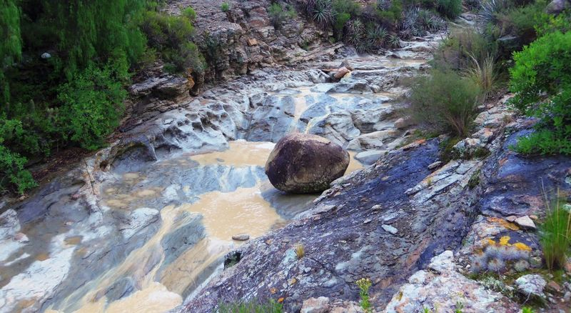Boulder in the creek compressed